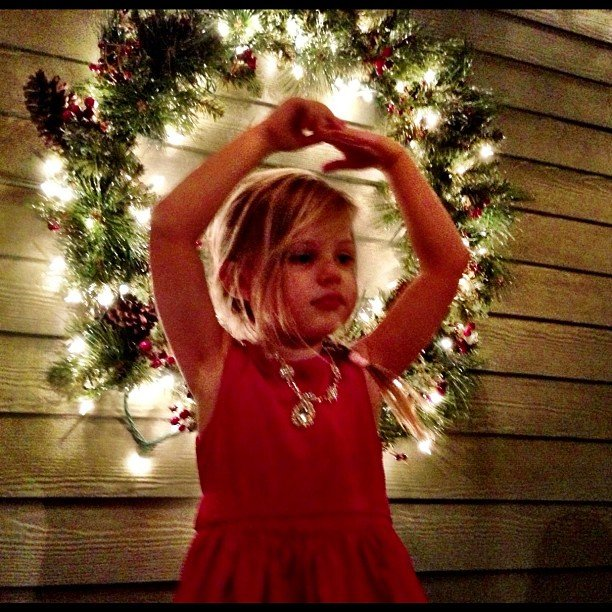 In 2014, Busy Philipps snapped a photo of her daughter, Birdie, posing in front of a Christmas wreath.