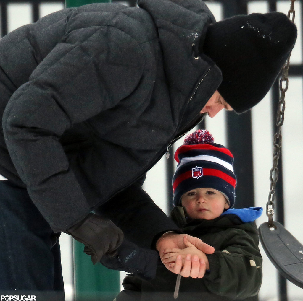 Tom Brady played with his sons on a swing set.