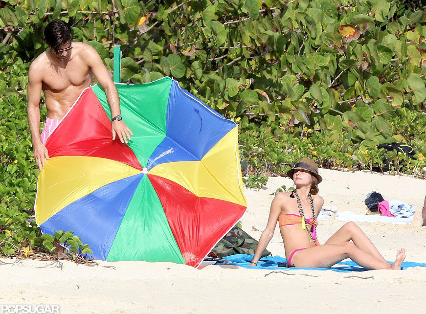 Olivia Palermo's boyfriend, Johanne Huebl, tried to fix their broken beach umbrella while they vacationed together in St. Barts in January 2013.