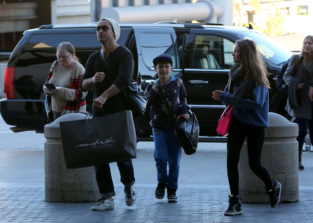 Jude Law and his children Iris and Rudy caught a flight at LAX.