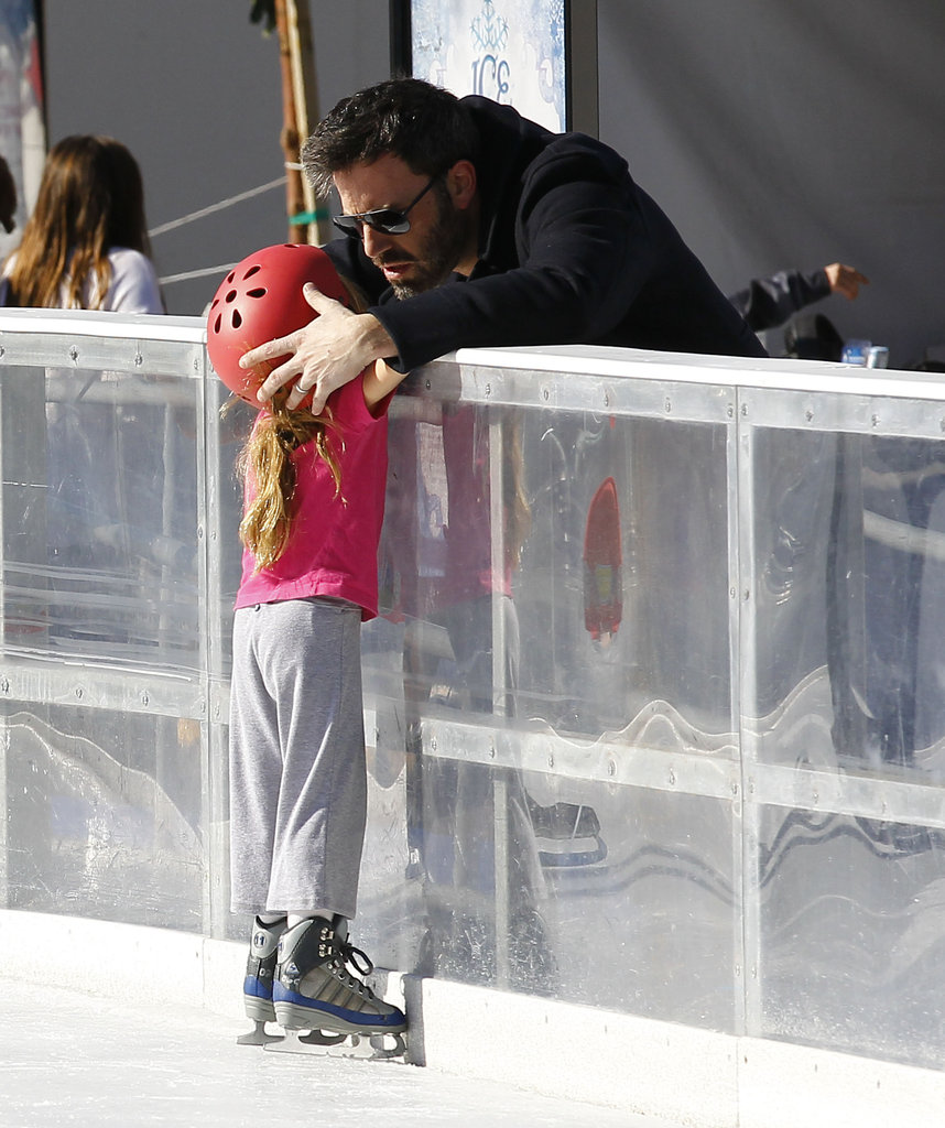 Ben Affleck adjusted Seraphina's helmet as she headed out on the ice.