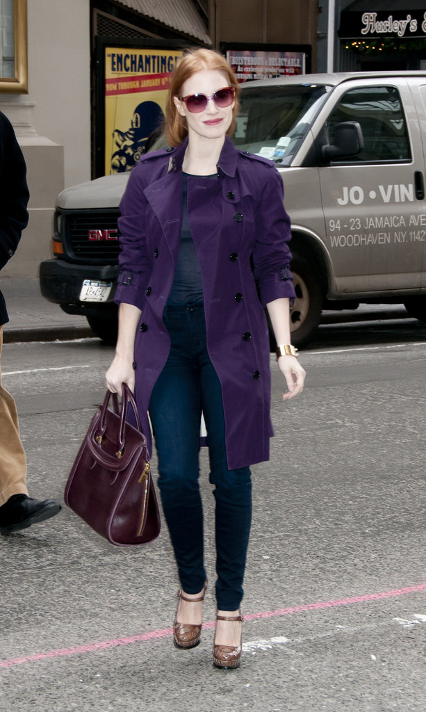 Jessica Chastain stayed polished but furthered her outfit interest with a plum-hued trench coat on top of her skinny jeans and heels.