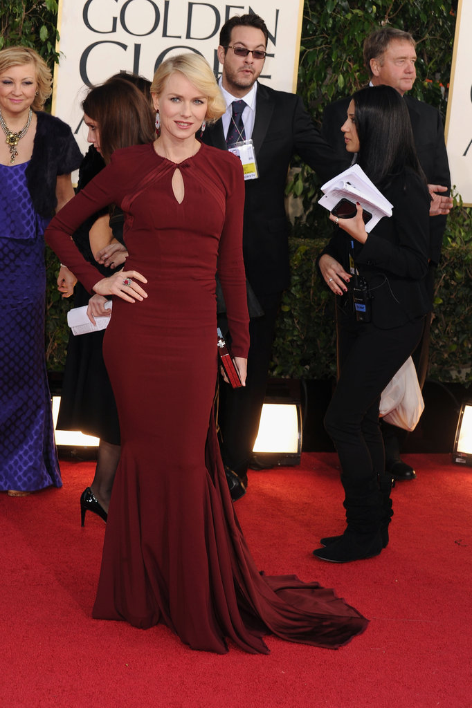 Naomi Watts poses in a red Zac Posen gown.