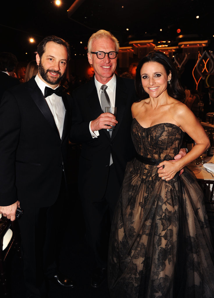 Julia Louis-Dreyfus, Brad Hall, and Judd Apatow were all smiles during the Golden Globes.