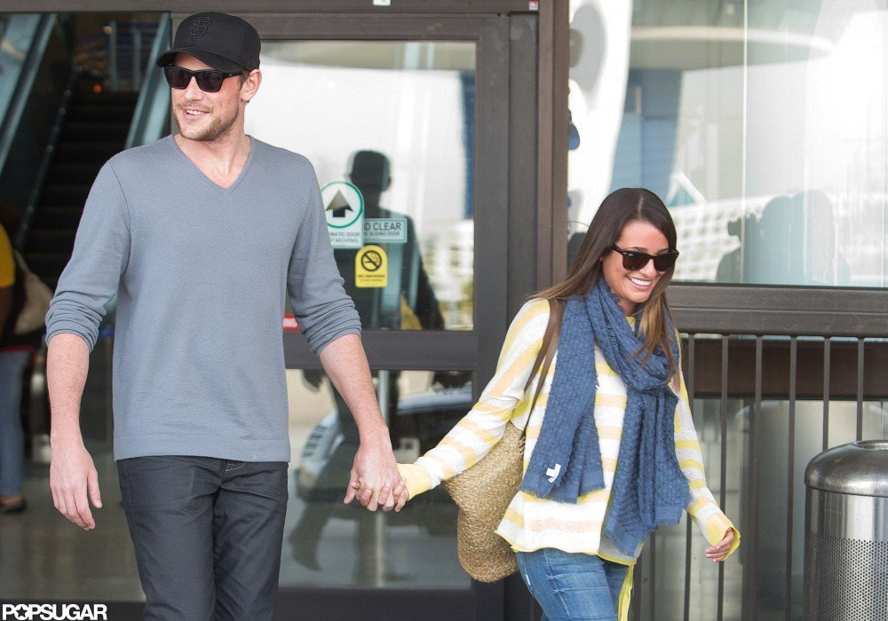 Lea Michele held Cory Monteith's hand as they got a ride home from LAX.