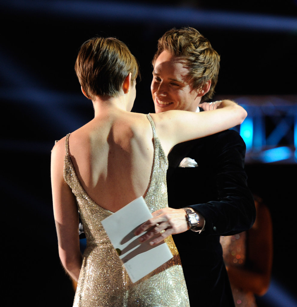 Eddie Redmayne hugged Anne Hathaway while presenting her with a Critics' Choice Award.