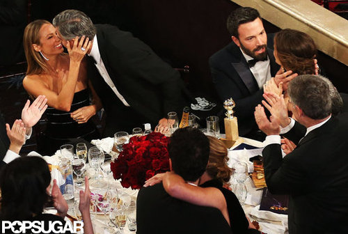 Stacy Keibler and George Clooney showed affection and Ben Affleck embraced Jennifer Garner at their table.