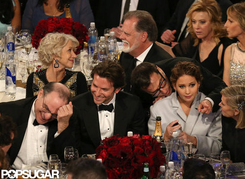 Bradley Cooper laughed alongside a bundled-up Jennifer Lawrence during the show.