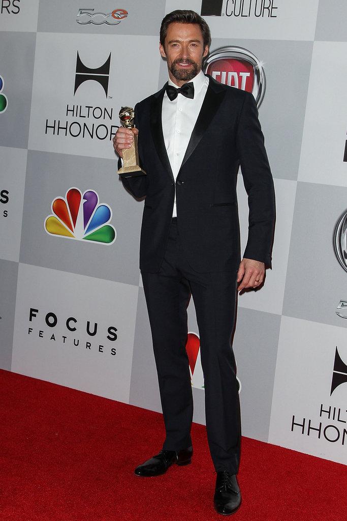 Hugh Jackman held up his Golden Globe.