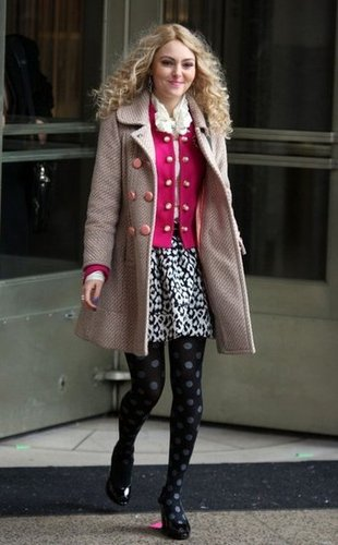 Carrie layered up in a pink cardigan, leopard skirt, polka-dot Hue tights ($9, originally $14), and a textured peach coat. Get inspired by Carrie's mixed-print masterpiece and pair her exact tights with this snow leopard Milly mini ($225).