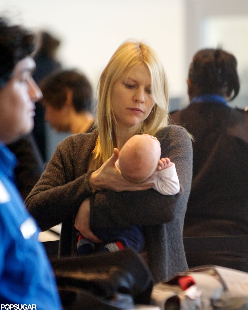 We had a first look at Claire Danes's baby, Cyrus Dancy, as they caught a flight out of LAX following the Golden Globes.