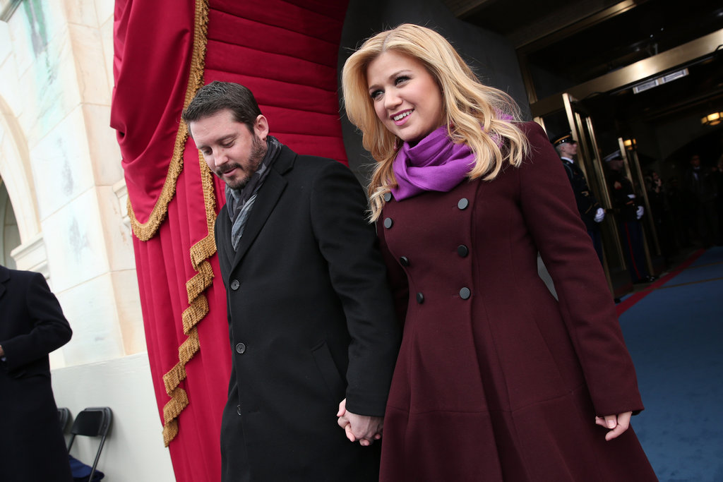 Kelly Clarkson, who also sang in this morning's swearing-in ceremony, offset a burgundy coat with a lighter fuchsia scarf.