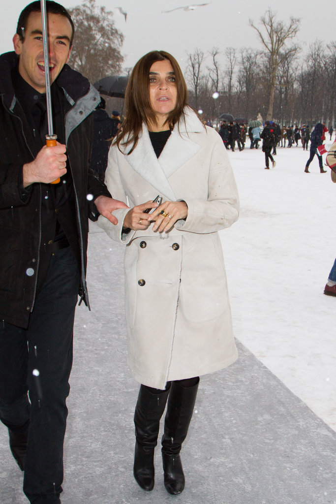Carine Roitfeld started with a chic black base, then threw on an off-white double-breasted coat for mega warmth.