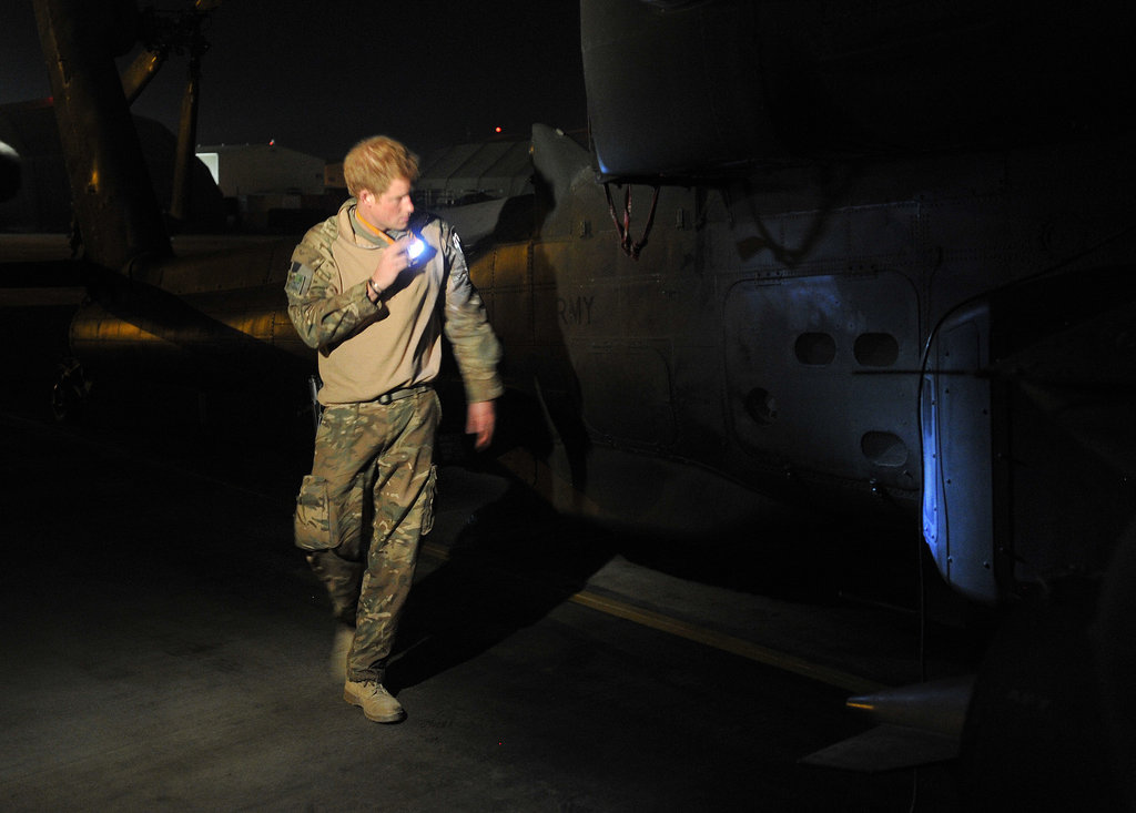 Prince Harry inspected an Apache helicopter before liftoff in December.