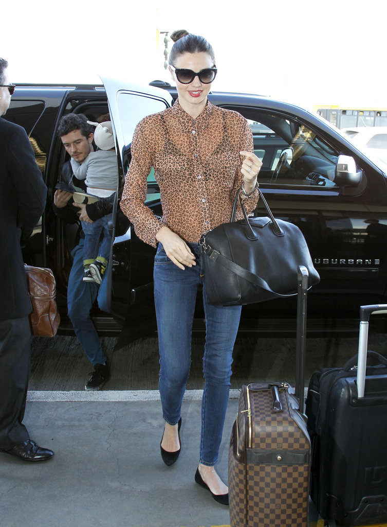 Miranda Kerr arrived at the airport with Orlando Bloom and Flynn.