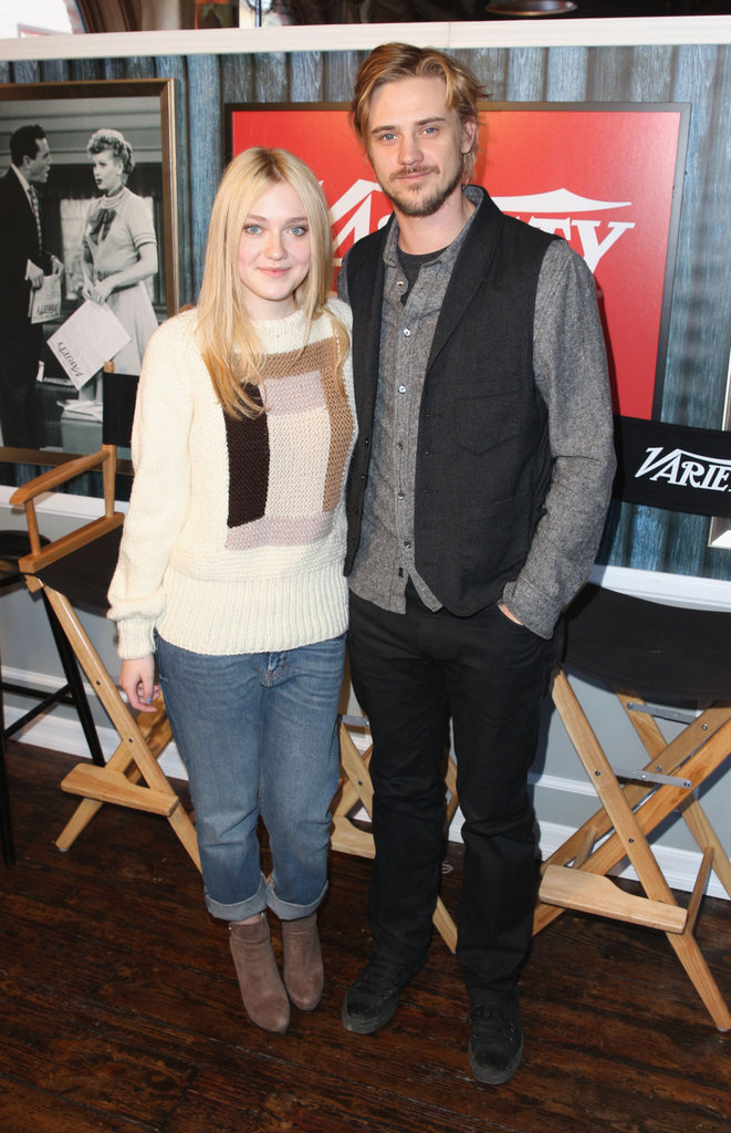 Dakota Fanning donned boyfriend jeans and suede ankle boots while posing with Boyd Holbrook.