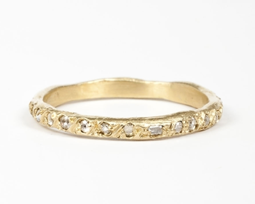 For the girl who tends to gravitate toward rougher finishes and offbeat baubles, this Elisa Solomon Ancienne diamond band ($1,670) offers up a delicate heirloom piece that, due to its handmade shape, is a one-of-a-kind, made-to-order ring.