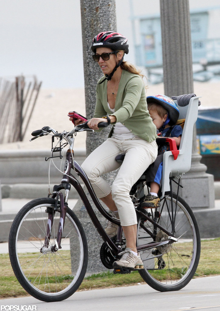 Sheryl Crow rode a bike with Levi on the back.
