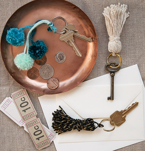 We can never find keychains we like but we've fallen hard for these DIYtassels and mini pom poms! Source: Design*Sponge