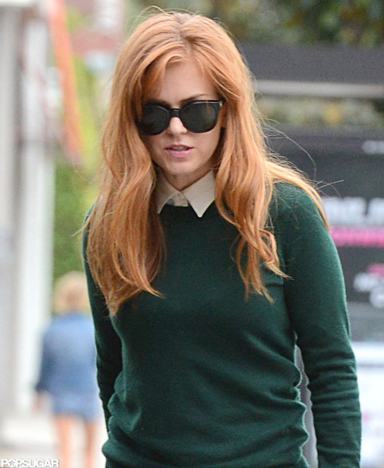 Isla Fisher wore a green sweater during a recent outing in LA.