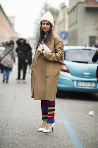 A classic camel coat is the perfect, simplified piece of outerwear to juxtapose statement pants. Source: Adam Katz Sinding
