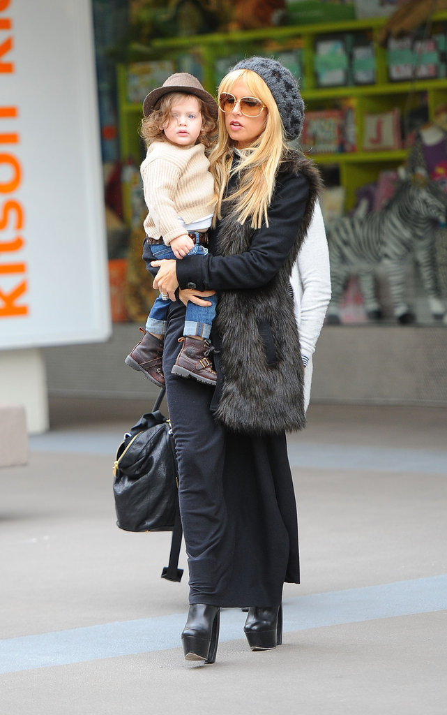 Rachel Zoe spent time with her son, Skyler, in her signature style: fur vest, black maxi dress, platform boots, and a slouchy leopard-print beanie.