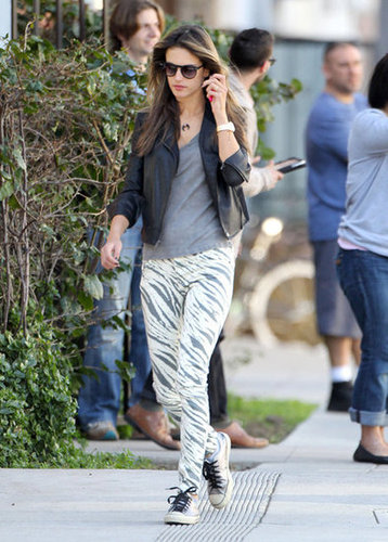 Alessandra Ambrosio dropped her daughter off at school wearing these funky Sass & Bide zebra skinny jeans ($270) with low-top sneakers, a gray tee, and a black leather jacket.