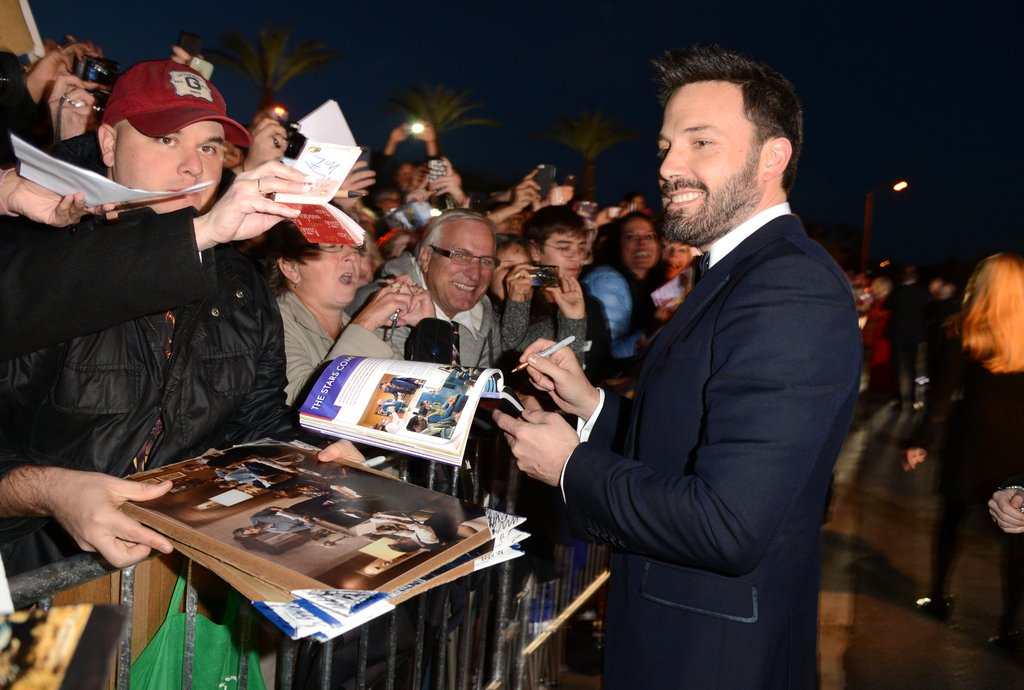 Ben Affleck signed autographs for fans outside the Palm Springs Film Festival.