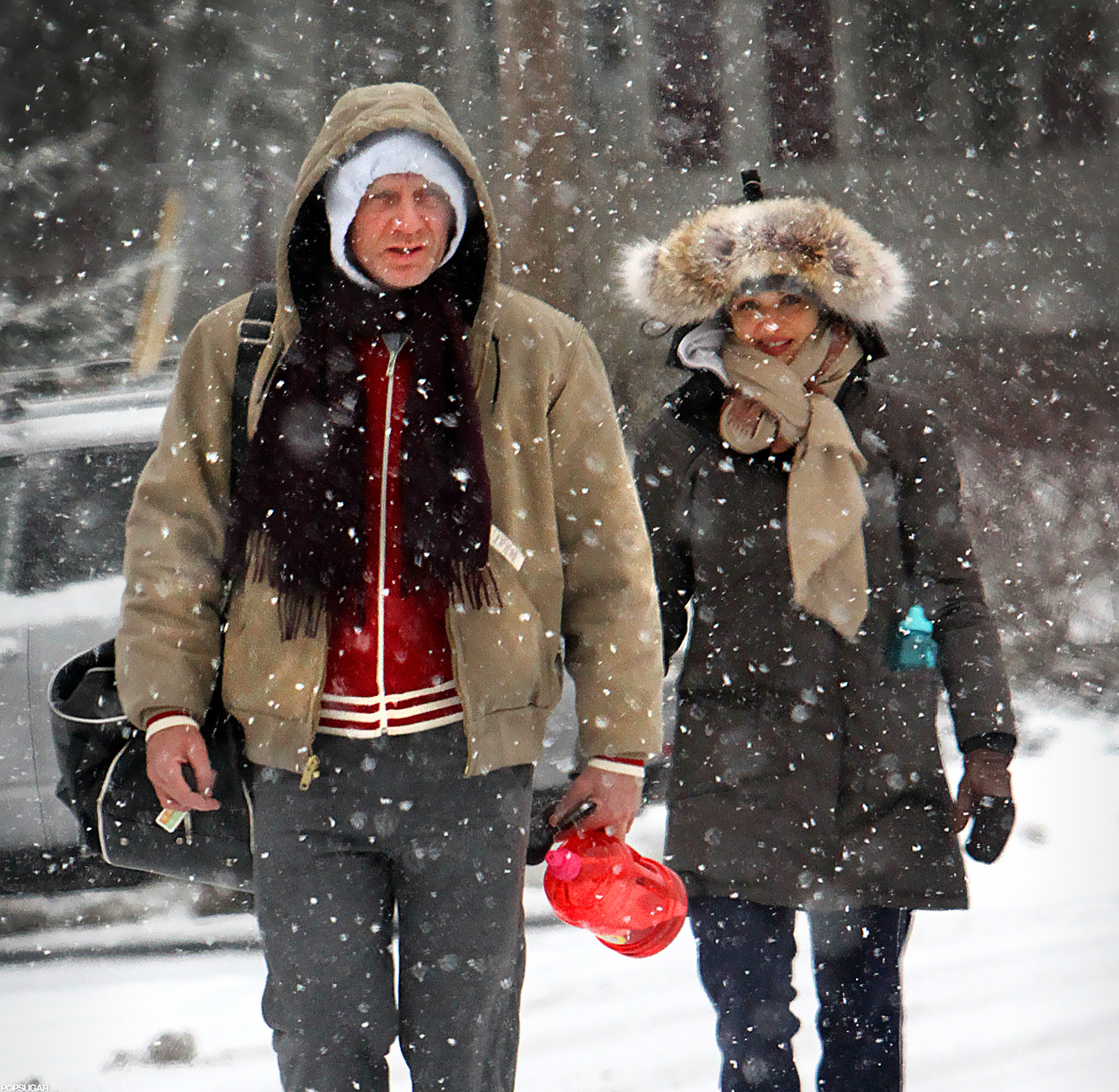 Daniel Craig carried a jug with him as he walked to a gym with Rachel Weisz.