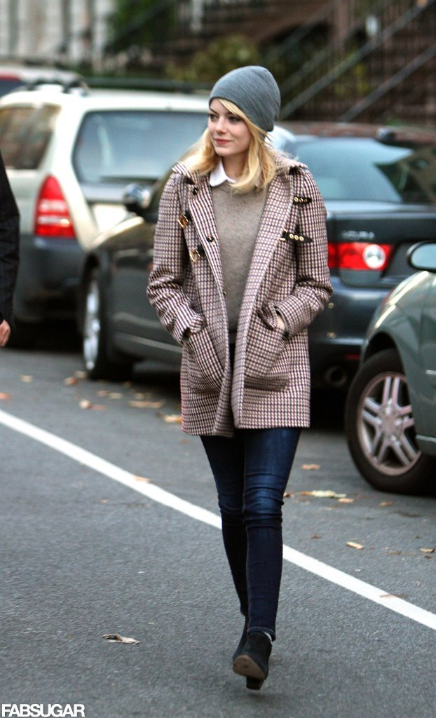 Emma Stone's plaid buckle coat, gray beanie, and signature sweater-cum-blouse duo were equal parts toasty and trendy.