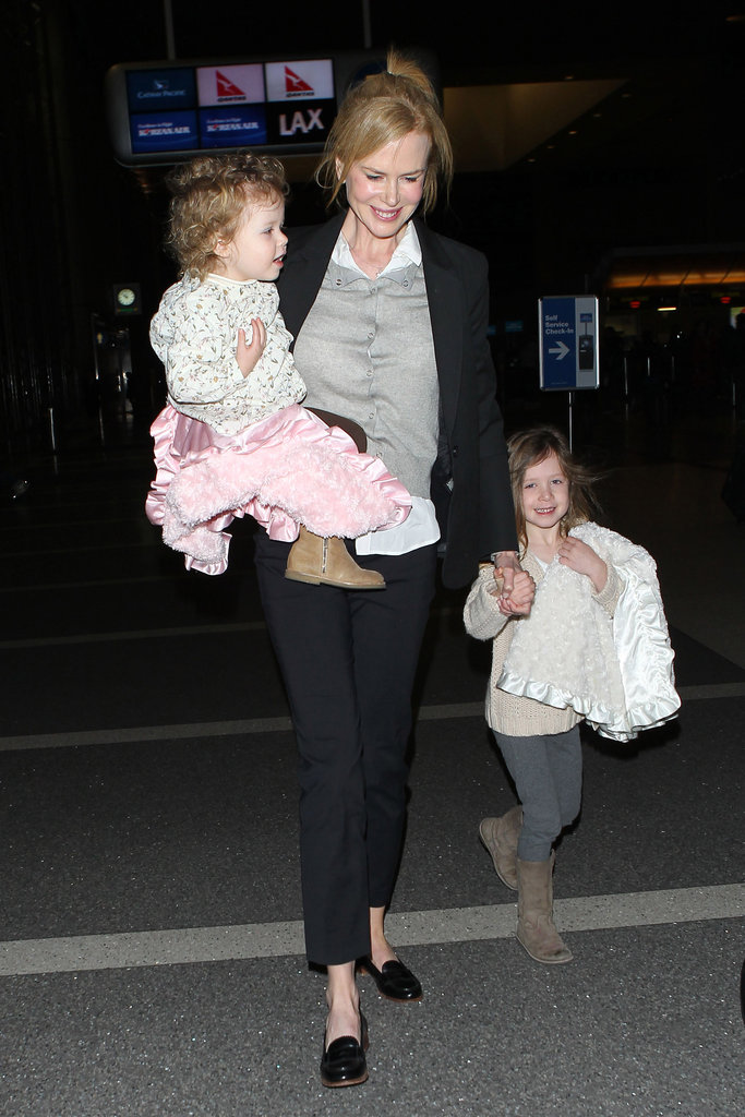 Nicole Kidman carried Faith Urban while holding hands with Sunday Urban at LAX.