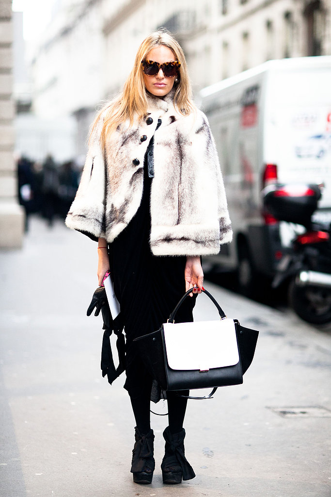 What's a more glamorous way to finish your look than with a fur cape — and a Céline tote in hand? Source: Adam Katz Sinding