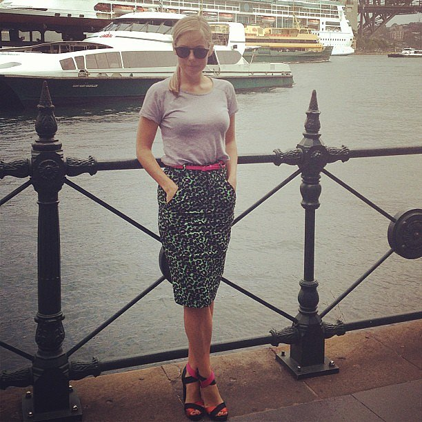 """Ali wears Anna & Boy skirt, Zara tee and heels.  """"I bought this grey tee from Zara over 2 years ago, for 7 Euros – literally – 7! Barely a week goes by without this puppy making an outing."""""""