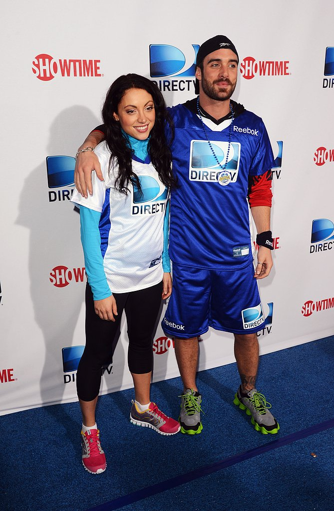 Joshua Sasse and Leah Gibson posed before heading in for the celebrity beach bowl game on Saturday in New Orleans.