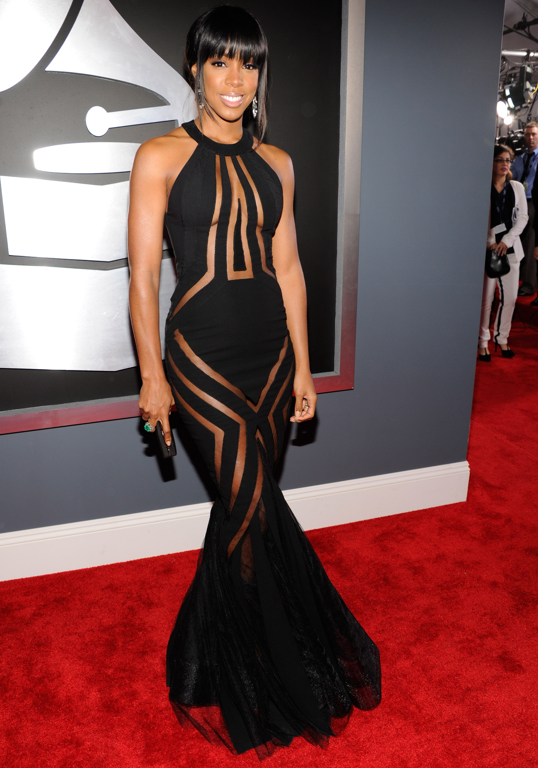Kelly Rowland wore a sheer black dress on the Grammys red carpet.