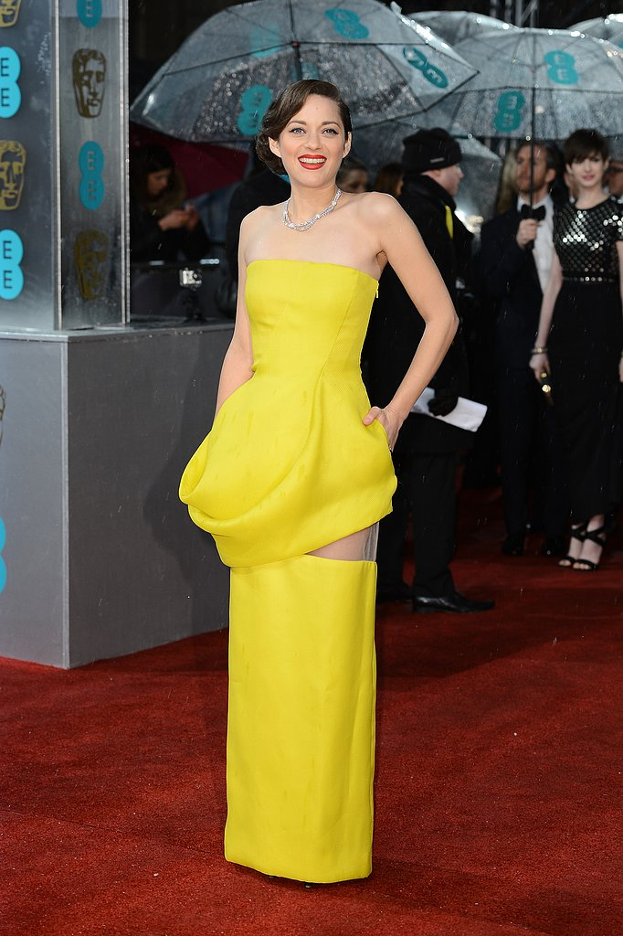 Marion Cotillard looked stunning in a yellow Dior gown.