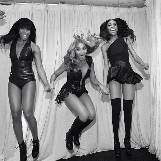 Beyoncé Knowles, Kelly Rowland and Michelle Williams jumped around backstage at the Super Bowl. Source: Instagram user baddiebey