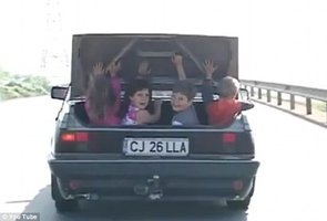 Shocking Video of Dad Driving with Children in Open Trunk (VIDEO)