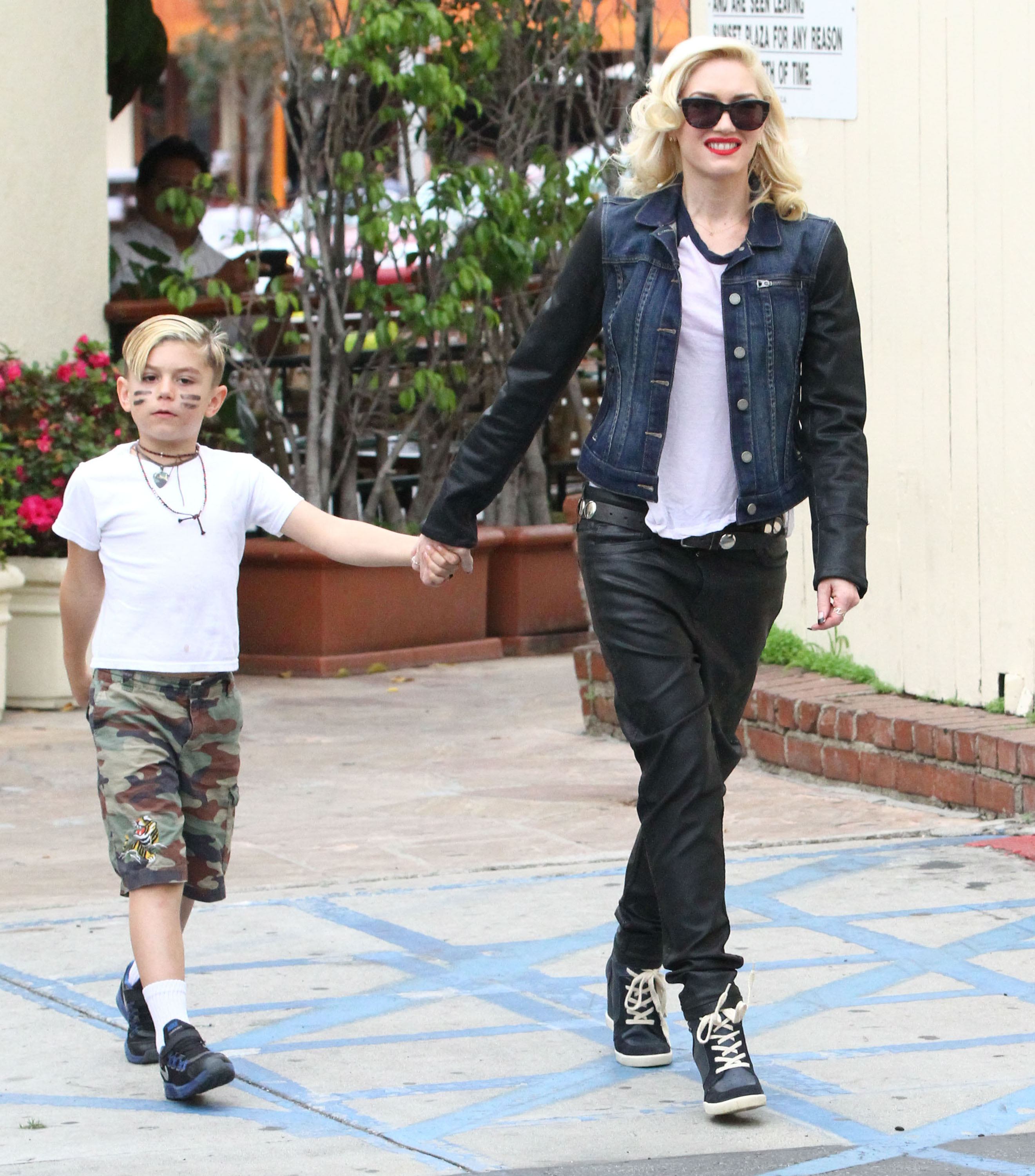 Gwen Stefani took her son, Kingston Rossdale, by the hand as they left a lunch date in LA.