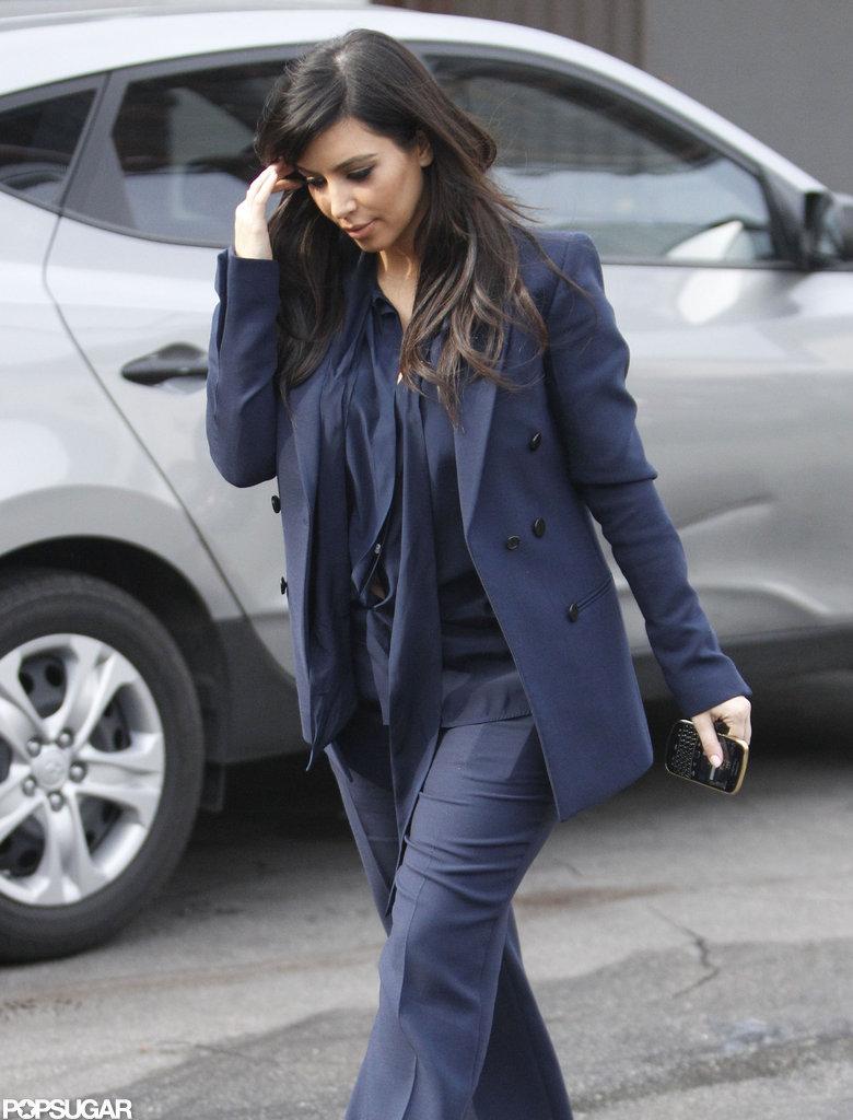 Kim Kardashian covered her baby bump with a blazer.