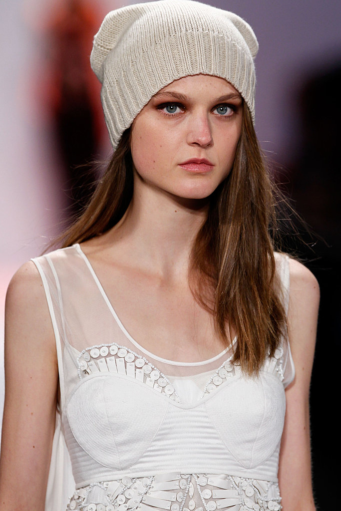 """The light, wispy, sideswept hair then got tucked under folded hats. """"It reminds me of a Turkish men's hat,"""" Philippon said of the look."""