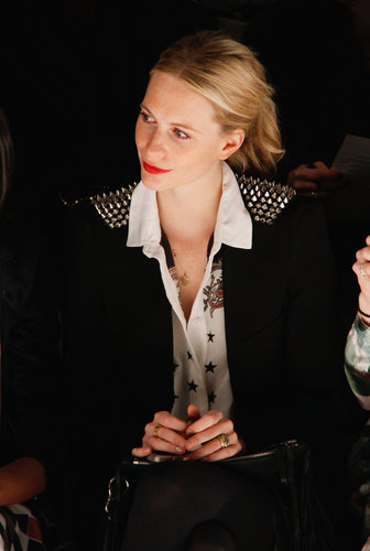 Sitting front row at Noon by Noor, Poppy Delevingne showed off her fashion-forward pairing: a printed silk blouse with a spiked blazer.
