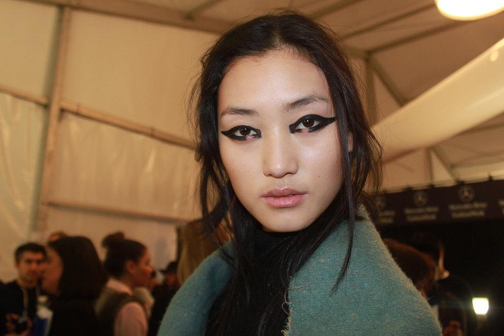 If you aren't quite bold enough to try this look on a Saturday night, draw a similar shape with black liner, making it shorter and thinner. Garland recommends smudging the shape and adding mascara for a similar look that's more wearable for the average woman.