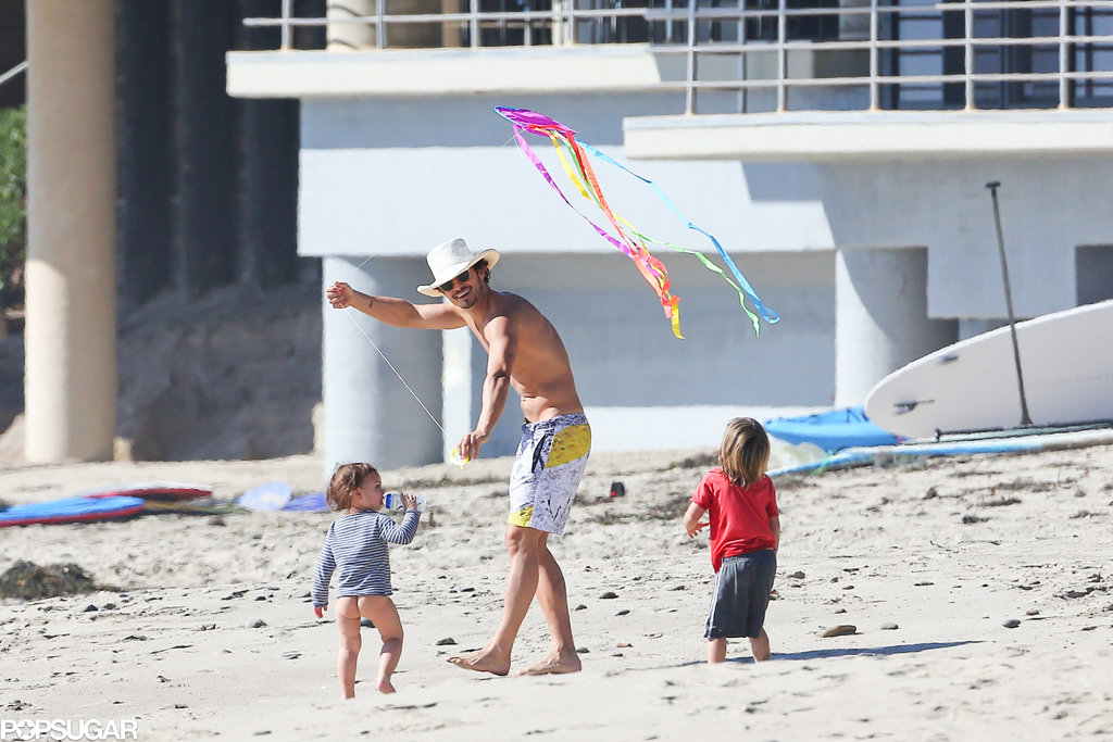 Shirtless Orlando Bloom hung out with his son, Flynn, on an LA beach.