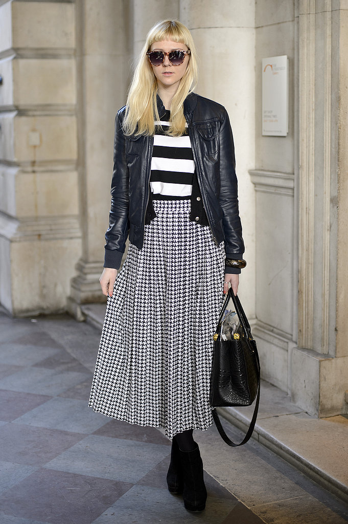 Ladylike meets punk, thanks to a full skirt and a leather topper.