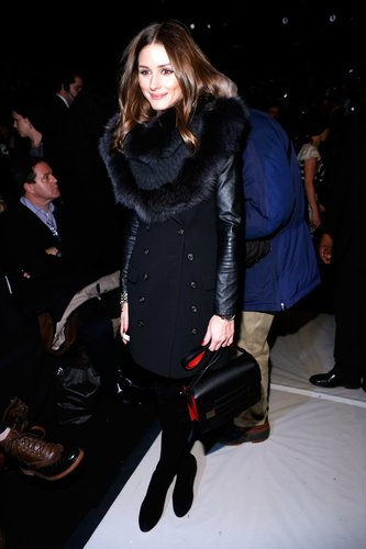 What's not to love about the mixed-texture masterpiece Olivia Palmero donned at Carolina Herrera? From her fur-trim snood to her leather-sleeved trench, it was all chic.