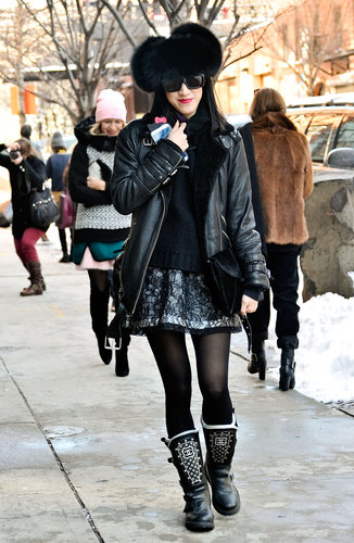 Bold texture and statement boots helped load this black-on-black ensemble with personality.