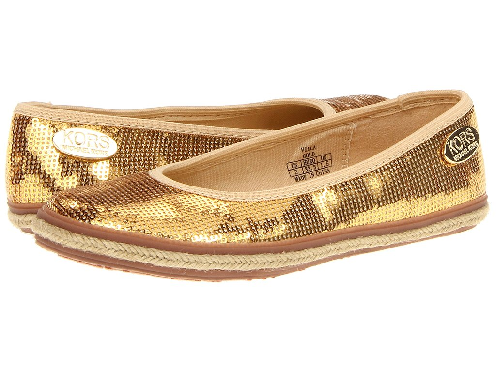 These shiny gold flats ($59) are sure to put her in the party mood.