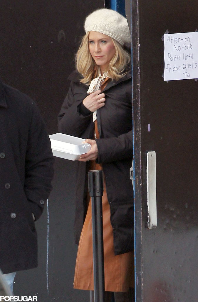 Jennifer Aniston carried food on set.