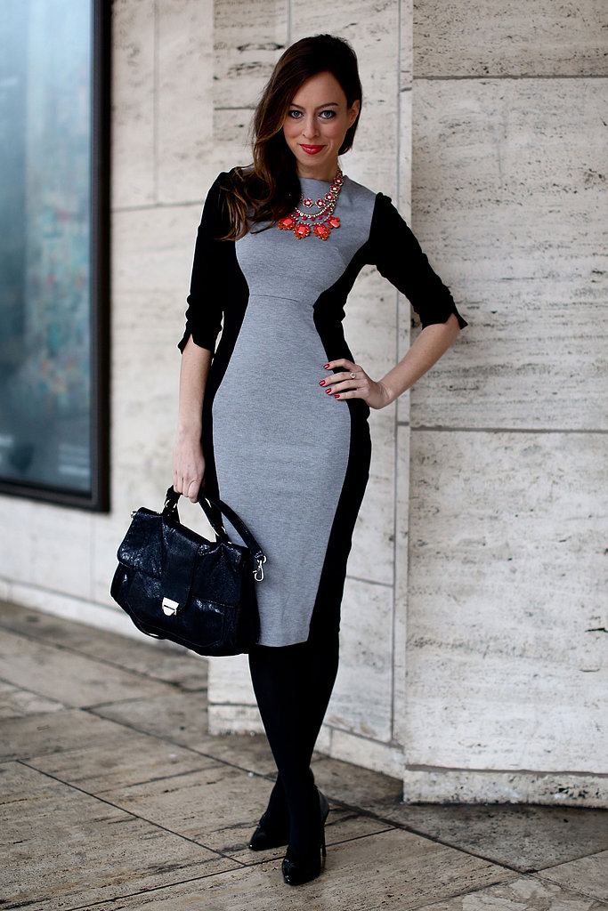 A sleek black and gray dress was the perfect foil to a richly hued statement necklace.